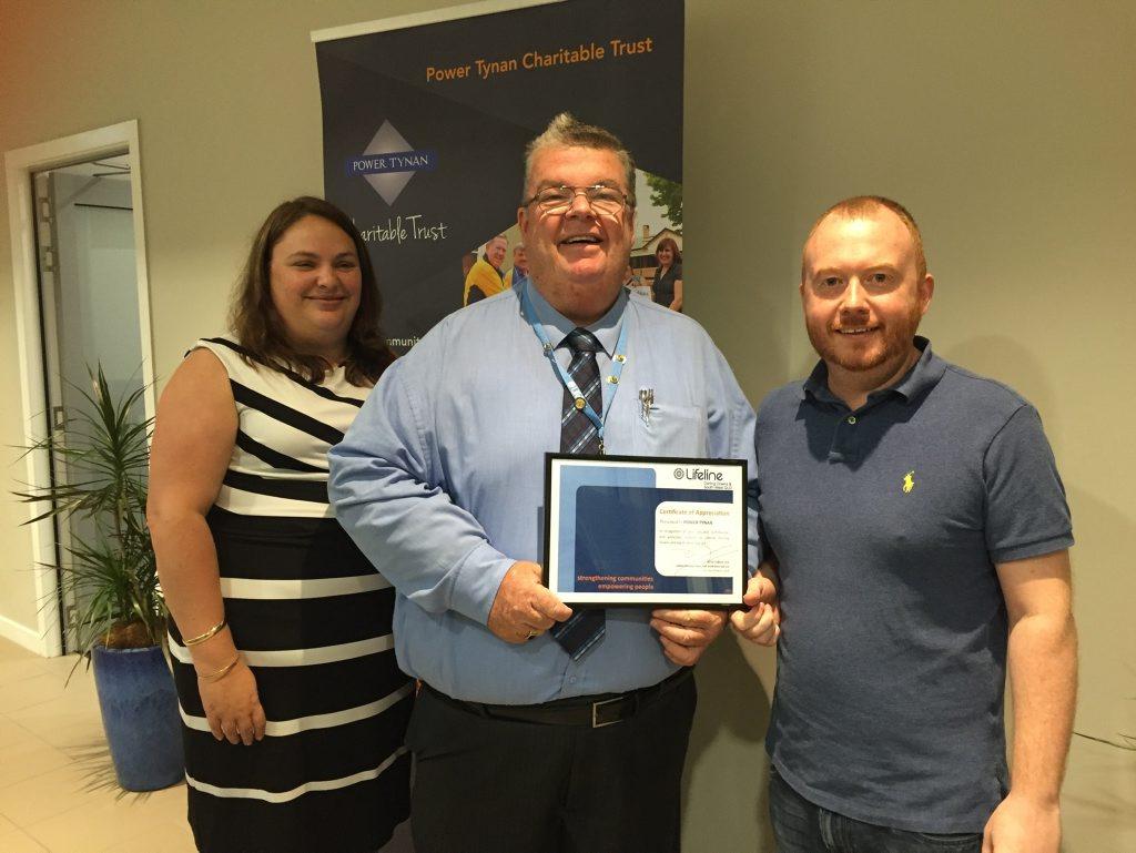 Lifeline Darling Downs CEO Derek Tuffield presents Power Tynan's Amanda Kenafake and Paul Best with a certificate of appreciation.