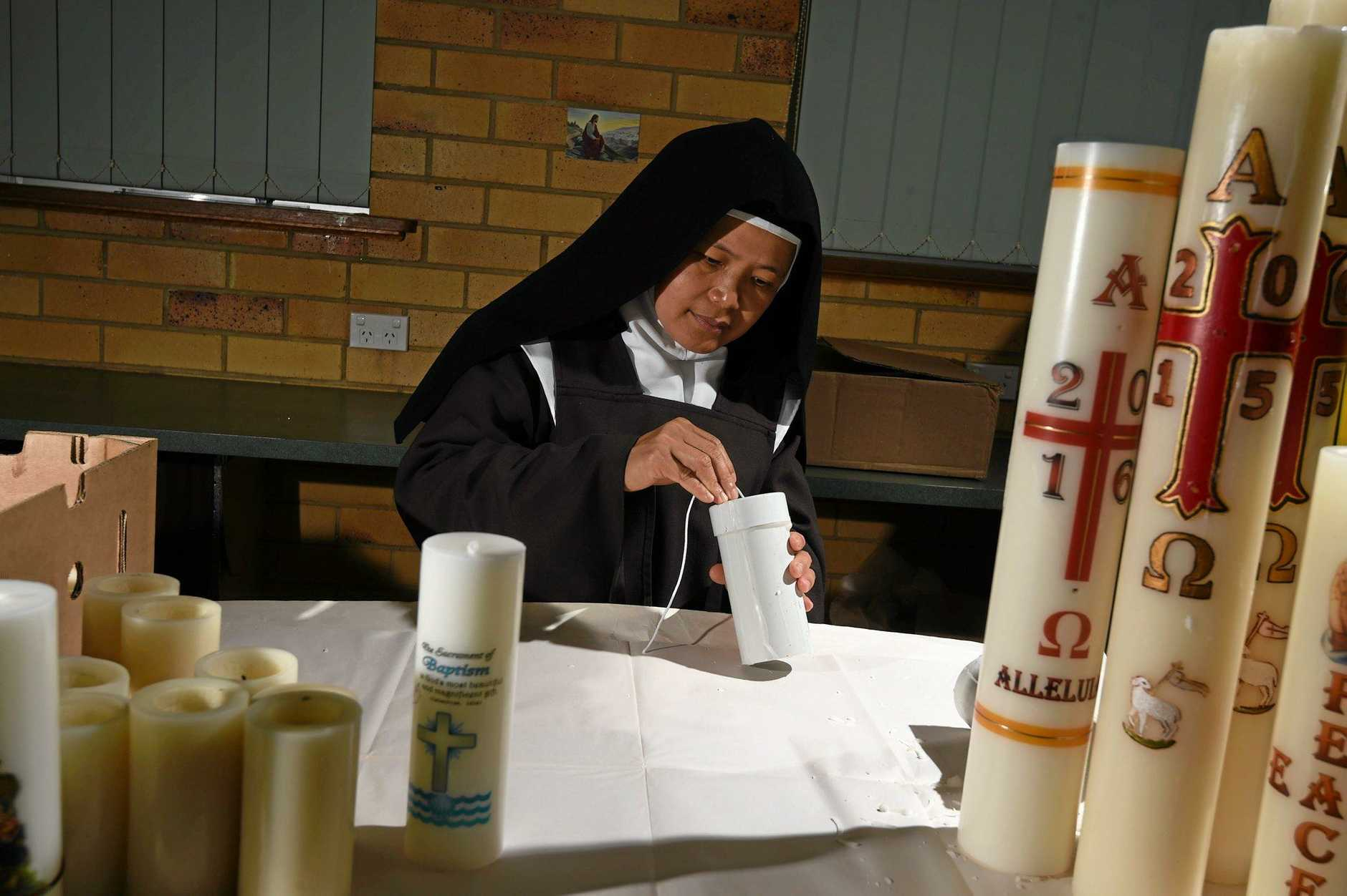 Sister Stephanie Marie making candles.