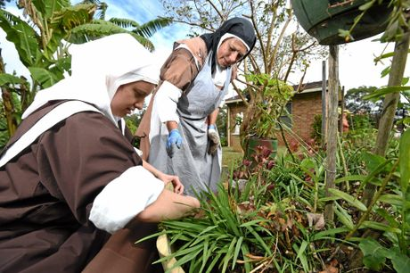 Sister Mary Rose and Sister Mary Antoinette working in the garden at the monastery.
