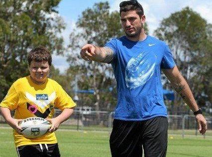 HELPING HAND: Zane Watkins gets some guidance from Matt Gillett at Sunshine Coast Stadium.