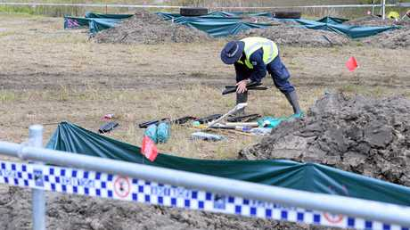 Police are collecting and sifting through mud in a Cobalt Street drain in Carole Park.