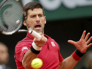 Djokovic loses temper but wins through