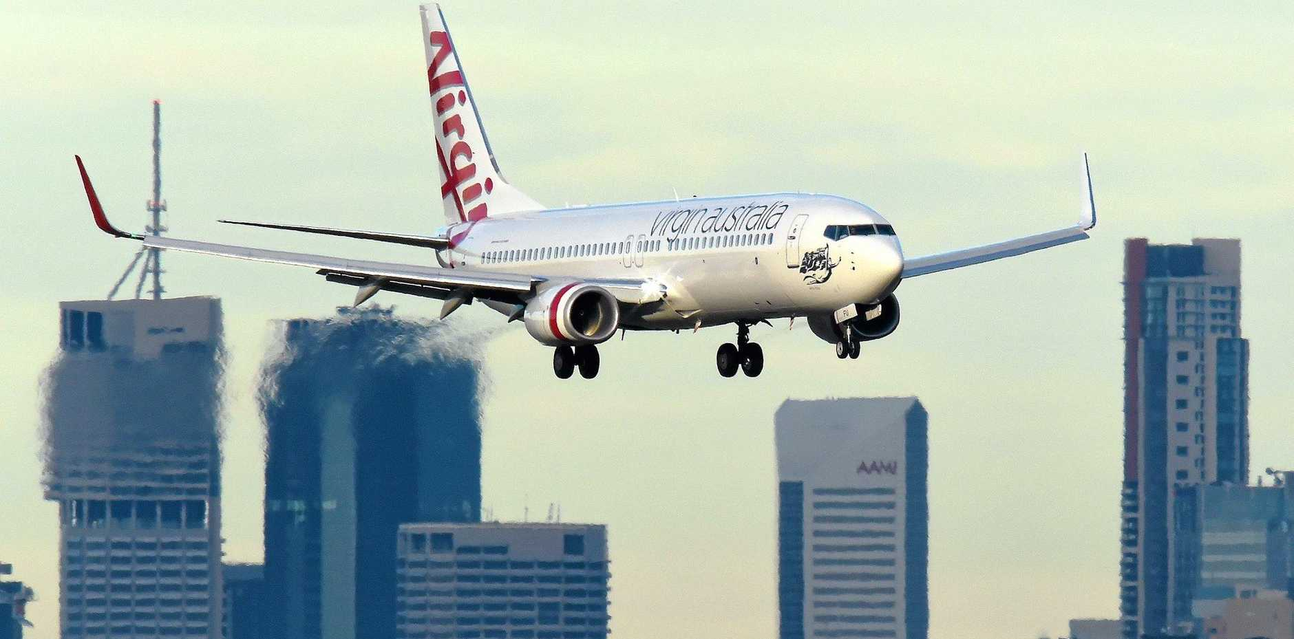 A Virgin Australia plane is seen on approach into Brisbane airport,