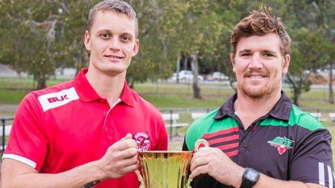 Currumbin Eagles player Brayden Evans and Bilambil Jets player Mitch Spackman with the Curtis Finn Memorial Trophy.