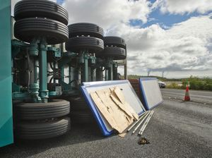 VIDEO, PHOTOS: 'My god!' Driver's shock at truck roll over
