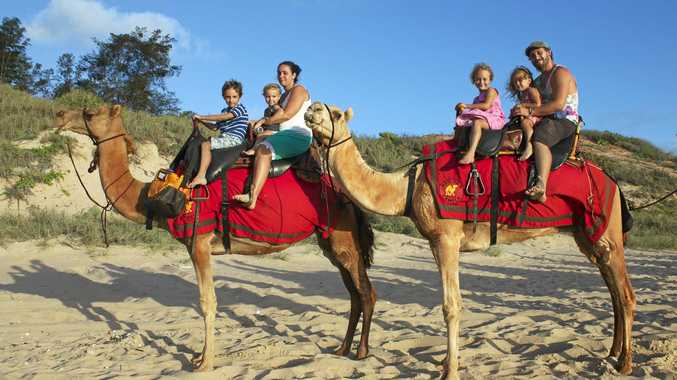 MEMORIES: The Dack family riding camels along Cable Beach at sunset in Broome, WA.