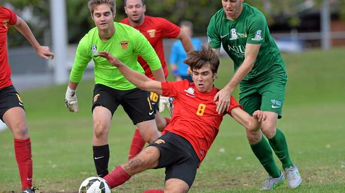 SLIP 'n' SLIDE: Sunshine Coast Fire's club captain Grant De Chastel slides for hte ball in his side's 3-1 loss to ladder leaders the Far North Queensland Heat at Bokarina on Sunday afternoon.