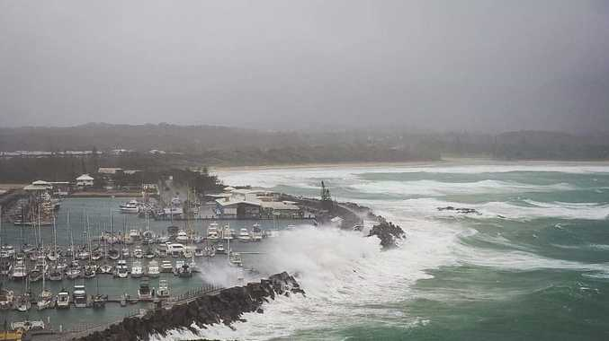 Scenes from high tides and damage at Coffs Harbour Marina.