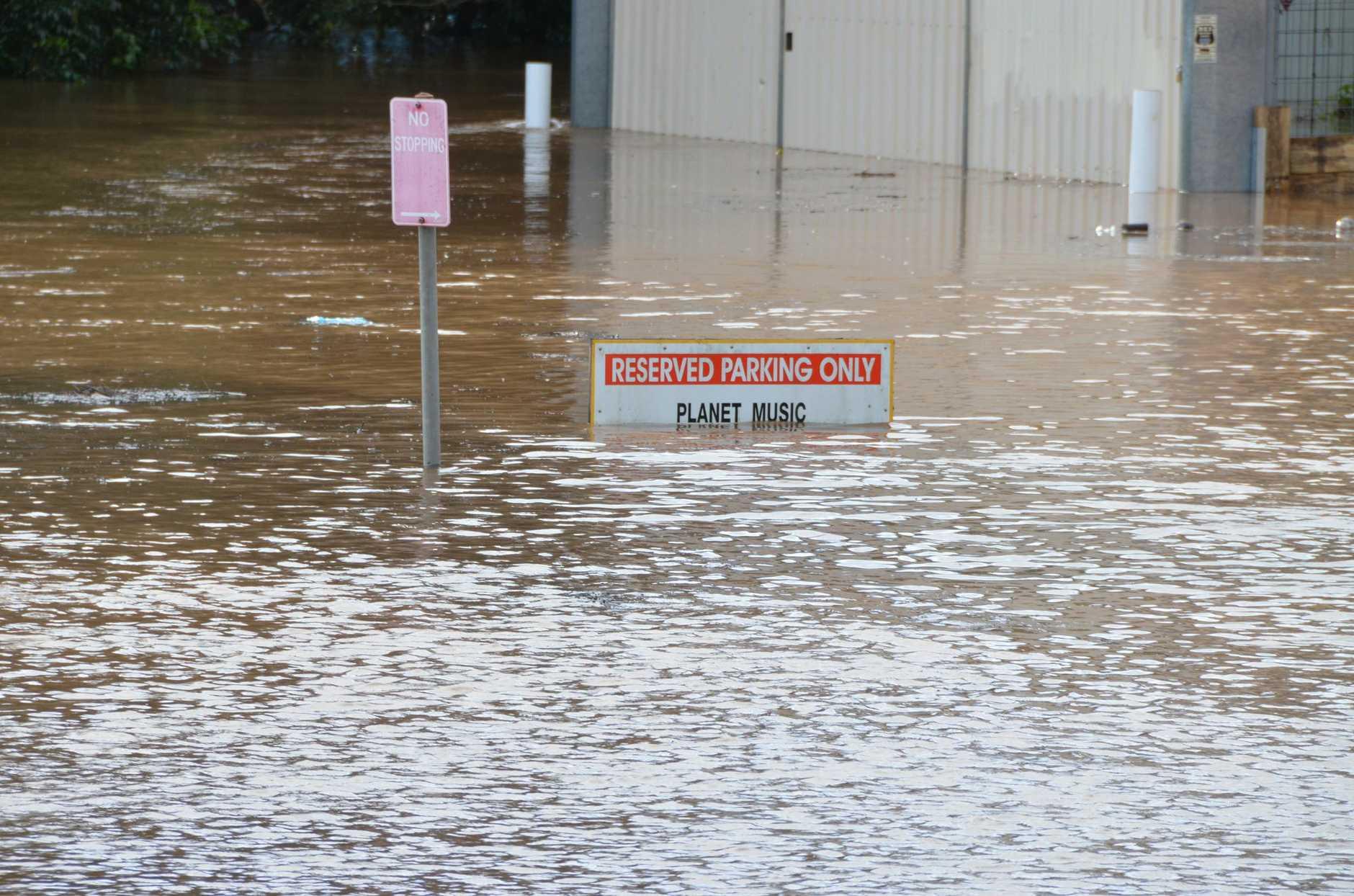 The carpark behind Sportspower Super Warehouse Lismore was completely submerged around 10am Sunday.