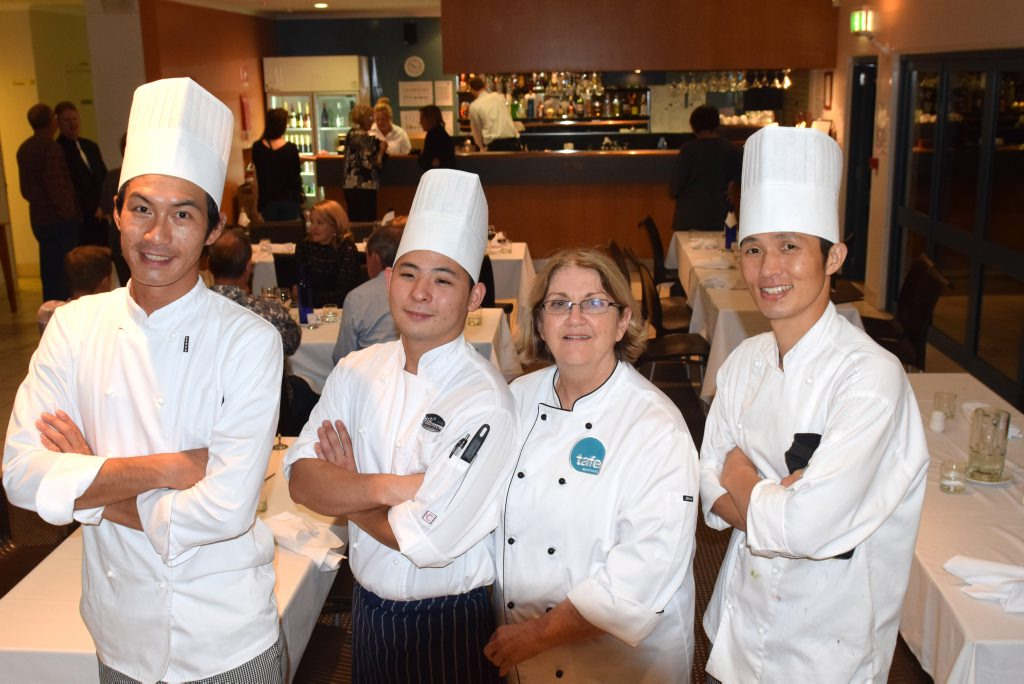 MASTER CHEFS: Tafe students On Cheung, Tak Tanaka and Sang Young Jean with cooking instructor Robyn De George after cooking up a gorumet ten course meal.