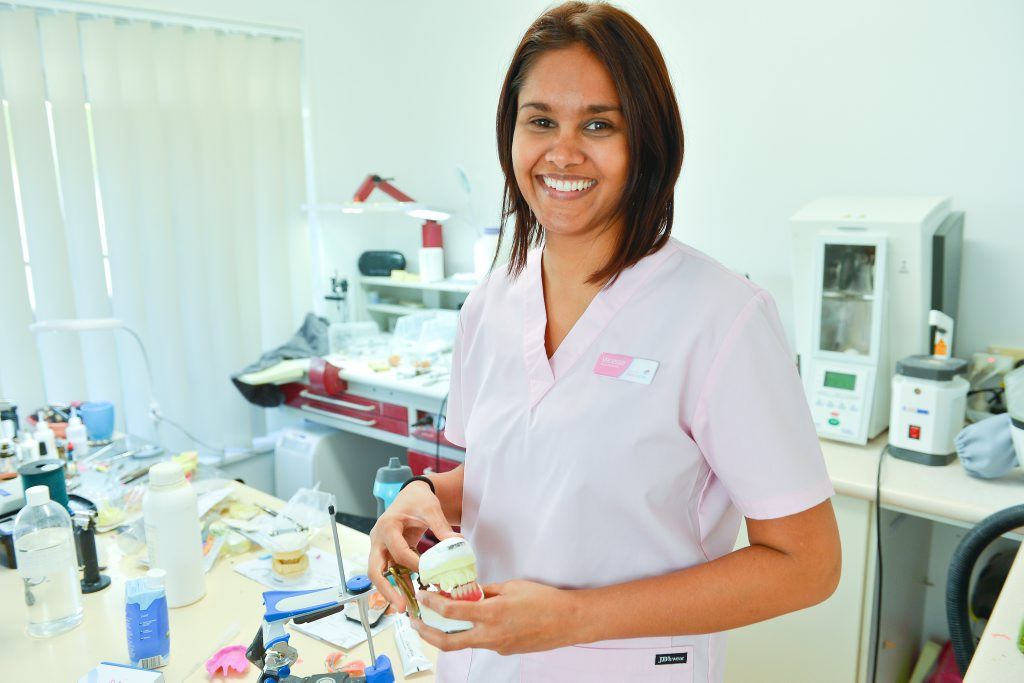 Denture Care owner Vanessa Chetty opened her first clinic in Gladstone last month. Photo Mike Richards / The Observer