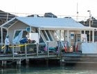DESTROYED: The Coffs Harbour Marina office was battered by high seas at the weekend.