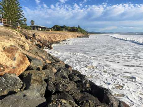 BELONGIL WASH OUT: The scene at Manfred St Belongil Beach after waves gouged out the sand cover over the new rock wall and exposed the foundations of the new steps. Saturday night's king tide saw water from nearby Belongil creek almost a half a metre deep cover a large section of Childe St. Sean and Joanne from Redcliffe in Queensland (pictured on the steps) were saying in a house on Childe St.