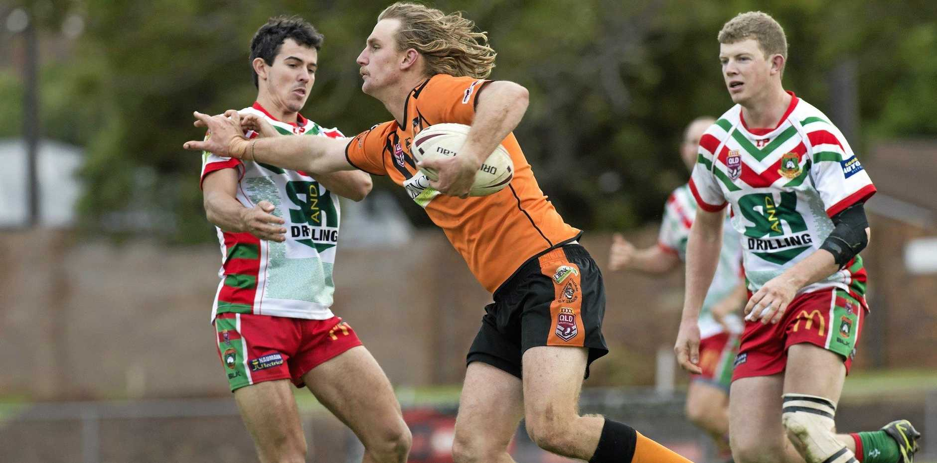FORCEFUL FEND: South centre Slade Martin tries to evade the Pittsworth defence at Clive Berghofer Stadium on Sunday.