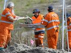 GRIM TASK: Police and SES volunteers resumed their search this week for Sharron Phillips' remains at a site in Carole Park.