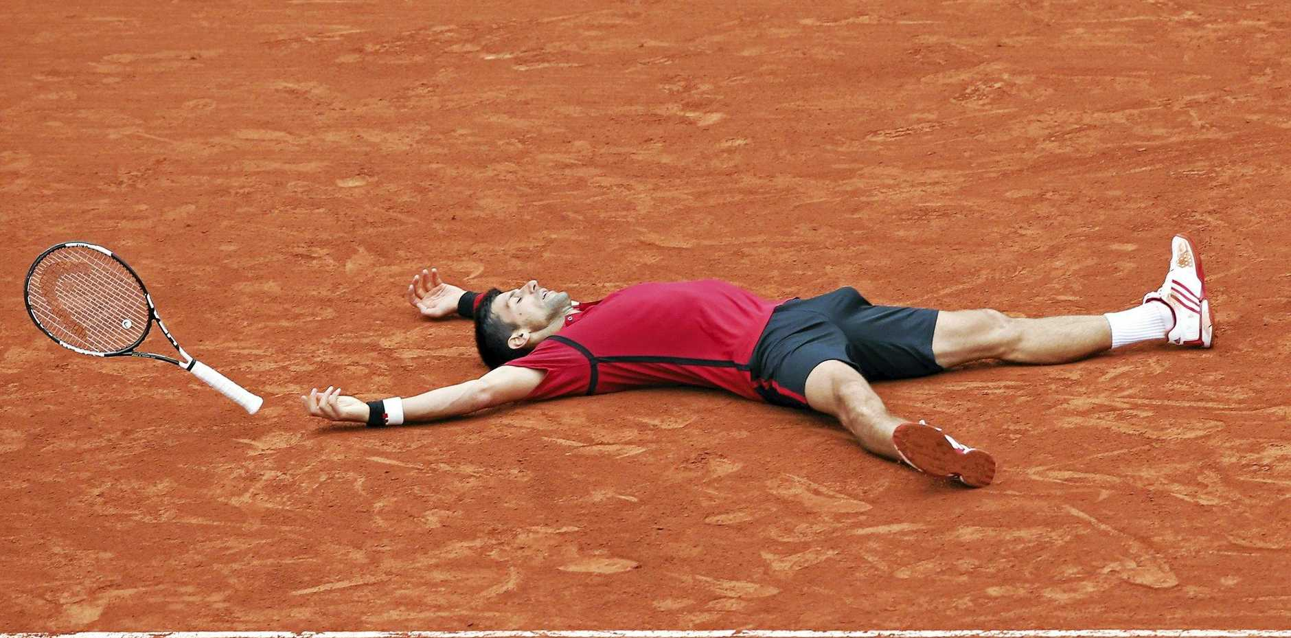 CLAY FEAT: A relieved Novak Djokovic tries to take in his win in the French Open.