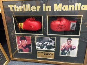 Coast cops seek owner of signed Muhammad Ali gloves