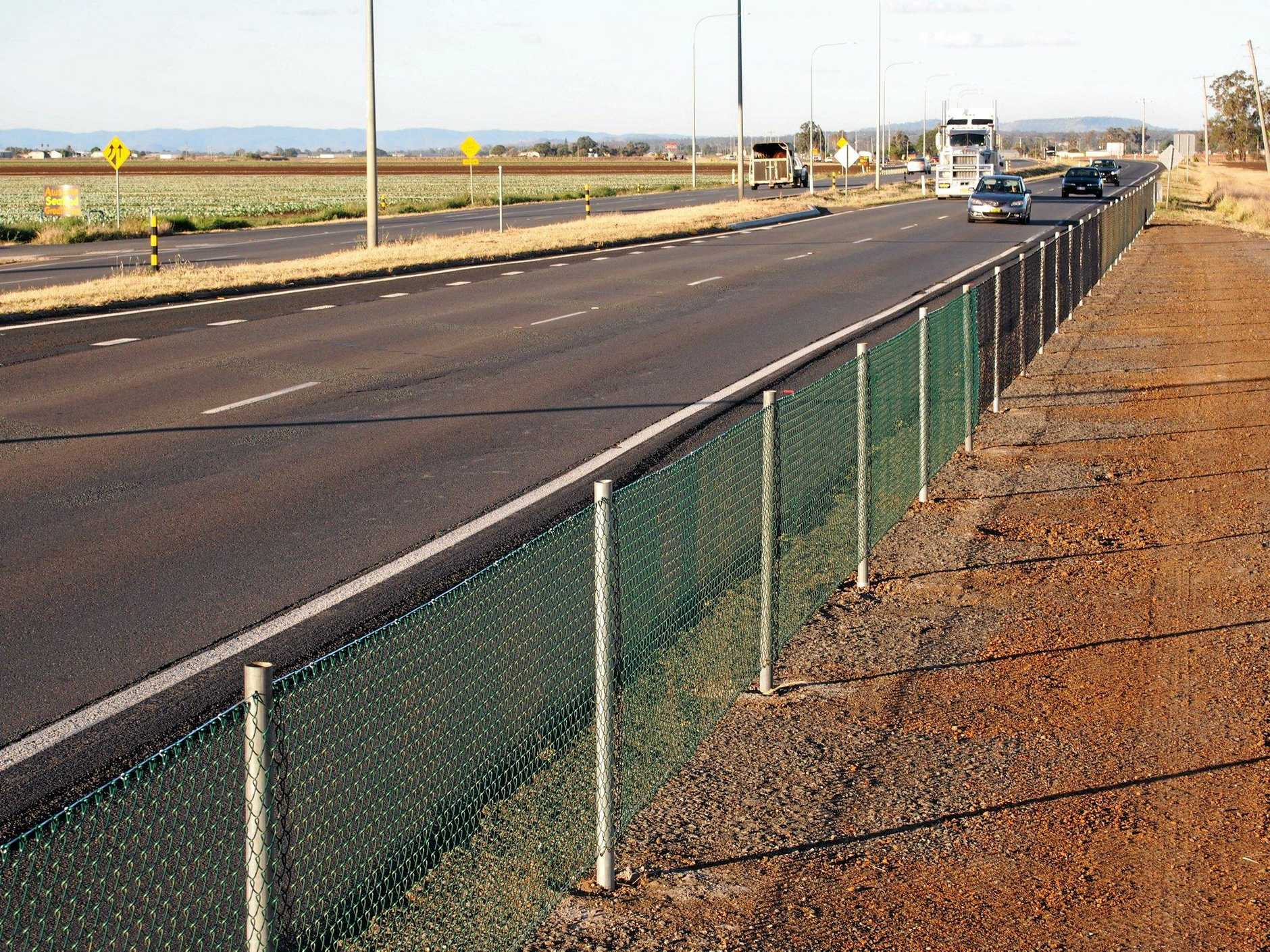 The fence that is stopping truckies from parking across from the McDonalds at Gatton.
