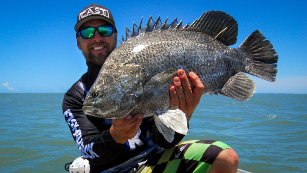 Daniel Powell with a tripletail fish he caught in the Gladstone region. Photo Contributed