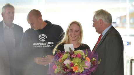Alyssa Azar receives flowers from Toowoomba region Mayor Paul Antonio. Photo Contributed