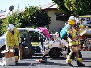 Neighbours assist crash victim as firies cut into car