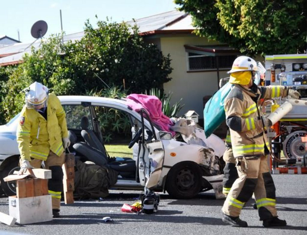 Emergency services clear the scene of a two-vehicle crash. A neighbours blanket was used to keep the woman in the vehicle warm while crews arrived.