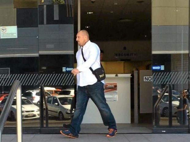 ACCUSED: Walter Robert Wintle, 40, leaves Maroochydore Court House during a break from his trial for robbery and fraud.