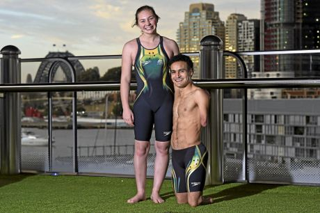 Maddison Elliott and Ahmed Kelly show off the new swim-suit.
