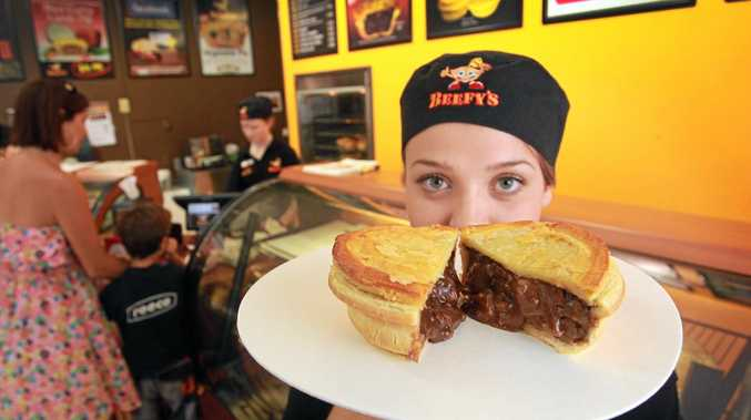 Loren Maher from Beefy's Pies at Buderim inspects the quality of one of their beef pies, which have much more meat than your average pie. Photo: Brett Wortman / Sunshine Coast Daily