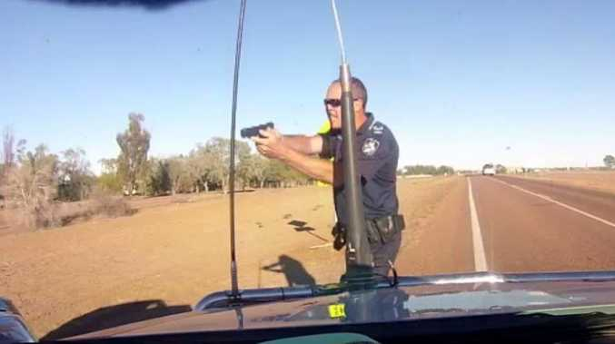 Queensland Police Senior Constable Stephen Flanagan pulls a gun on an alleged speeding driver