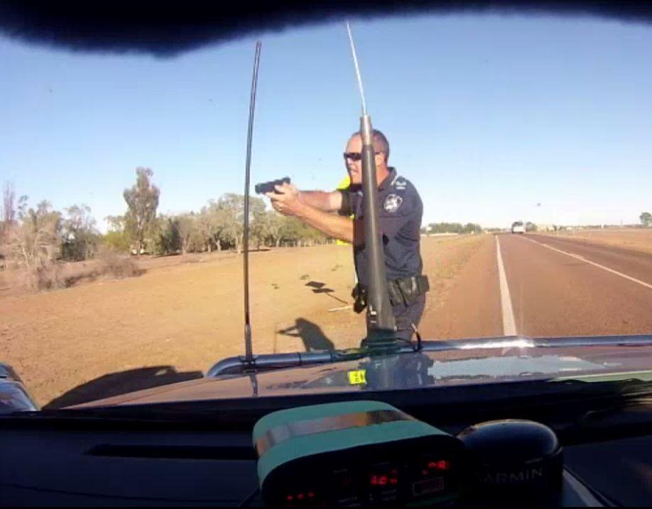 Queensland Police Senior Constable Stephen Flanagan pulls a gun on an alleged speeding driver