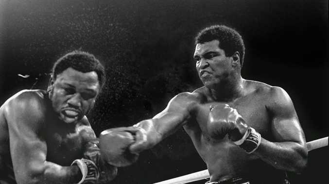 Then heavyweight champion Muhammad Ali connects with a right in the ninth round of his title fight against Joe Frazier in Manila, Philippines, Oct. 1, 1975. Ali won the fight on a decision to retain the title.