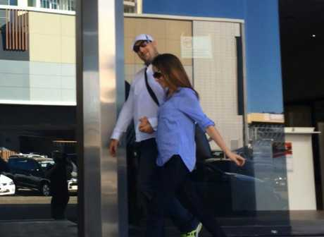Walter Robert Wintle, 40, and his ex-partner Jessica Whaley leave Maroochydore Court House after Wintle was found not guilty on charges of robbery and fraud.