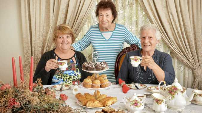 RAISING FUNDS: Gaylene Bauer, Pauline Watson and Sally Harrison prepare for their Biggest Morning Tea on Sunday.