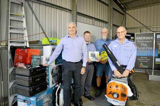 HAPPY: Energex acting group manager Steve Leadbetter, Coominya Rural Fire Service first officer Rod Sampson, Woodlea Rural Fire Service firefighter Jesse Russell and Withcott firefighter Des Ashin.