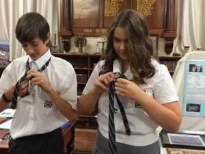 Maryborough State High students try to do their new ties