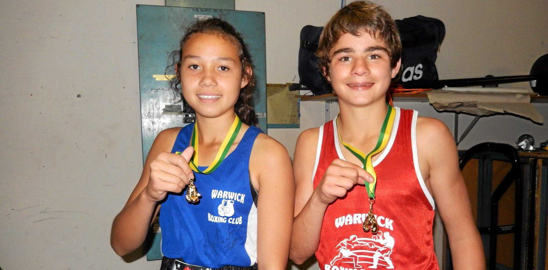 Rose City Boxing Club members Teresa Poole and Jacob Wyllie, pictured after winning State Golden Gloves championship medals, will compete this weekend at Nerang.
