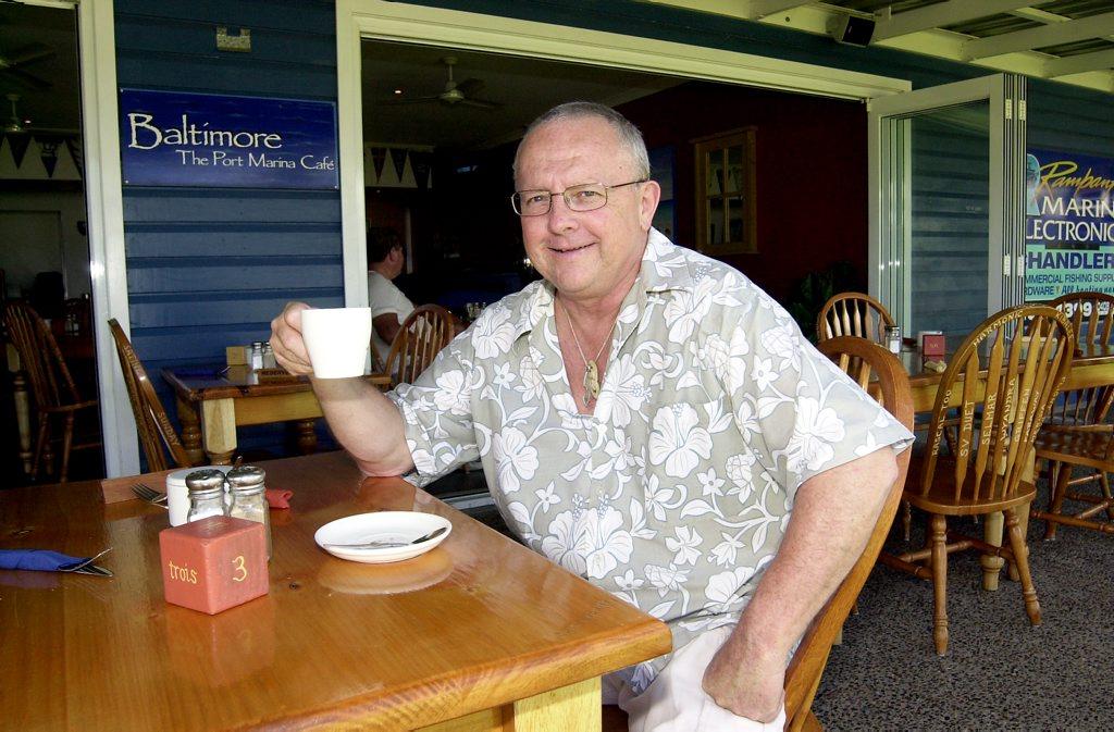 Former Baltimore owner Brad Dick enjoys a cuppa at his restaurant, at the Bundaberg Port Marina. Mr Dick built Baltimore after running Bradlees takeaway at Bargara, and later set up Casablanca at Bargara before retiring. Photo NewsMail Archives