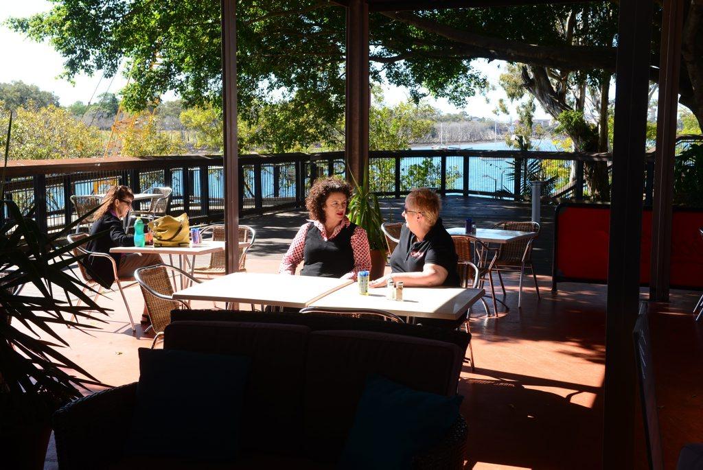 COFFEE BREAK: Customers enjoy the sunshine at the River Cruz Cafe. Photo: Max Fleet / NewsMail