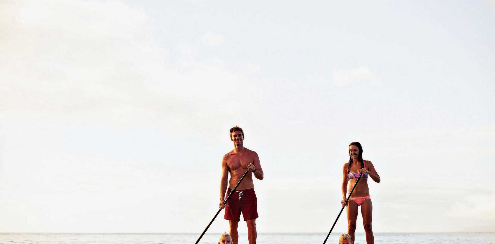Stand up paddling is a great exercise for the family to do together.