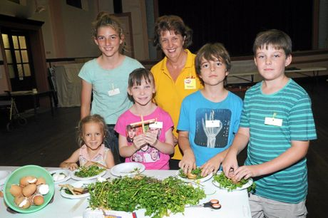 MESSY CHURCH: Mayah, Grace, Declan, Oscar, Chloe and Nancy Hammond at the resurrection garden activity table. File picture.