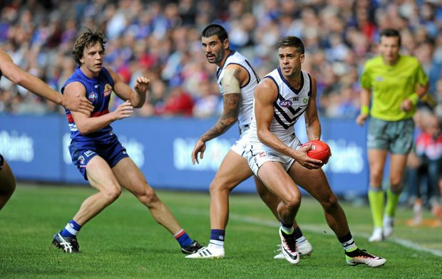 Not giving up hope ... Stephen Hill of the Dockers looks for someone to pass to.