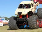 One Nation senate candidate Paline Hanson drives a monster truck over cars at Doomben on Friday.