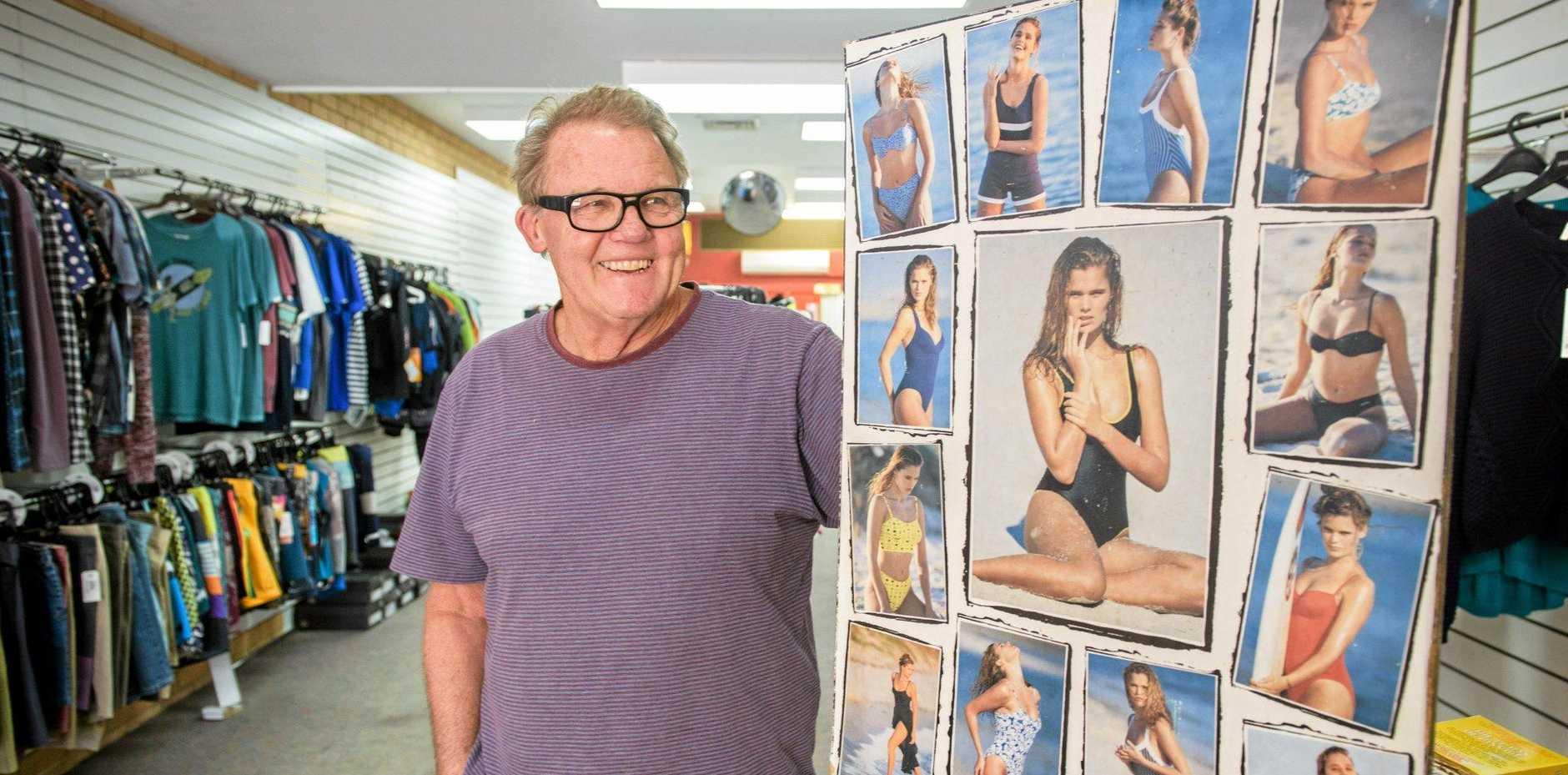Grant Dwyer of Fandango with an old poster of their Fandango swimwear.
