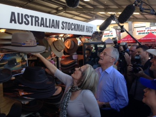 Malcolm Turnbull visited both Fairfax and Longman on the weekend. Here he buys wife Lucy a hat at the Sunshine Coast Show.