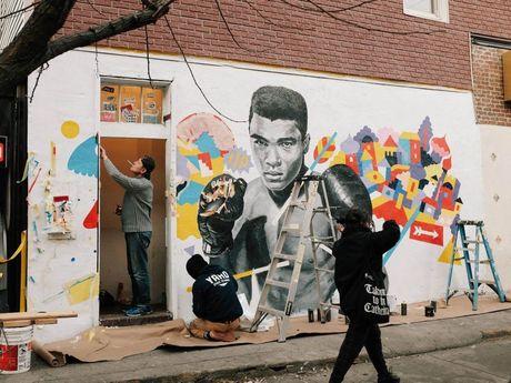 Brolga working on the iconic mural of Muhammad Ali. Photo Sam Sally Cha