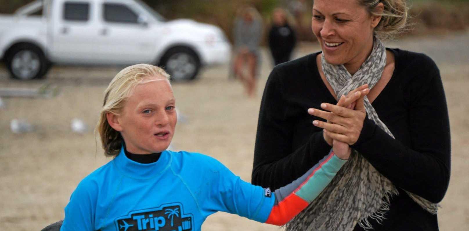 Phobe Kane gets some help from mum before her under-14 girls heat.