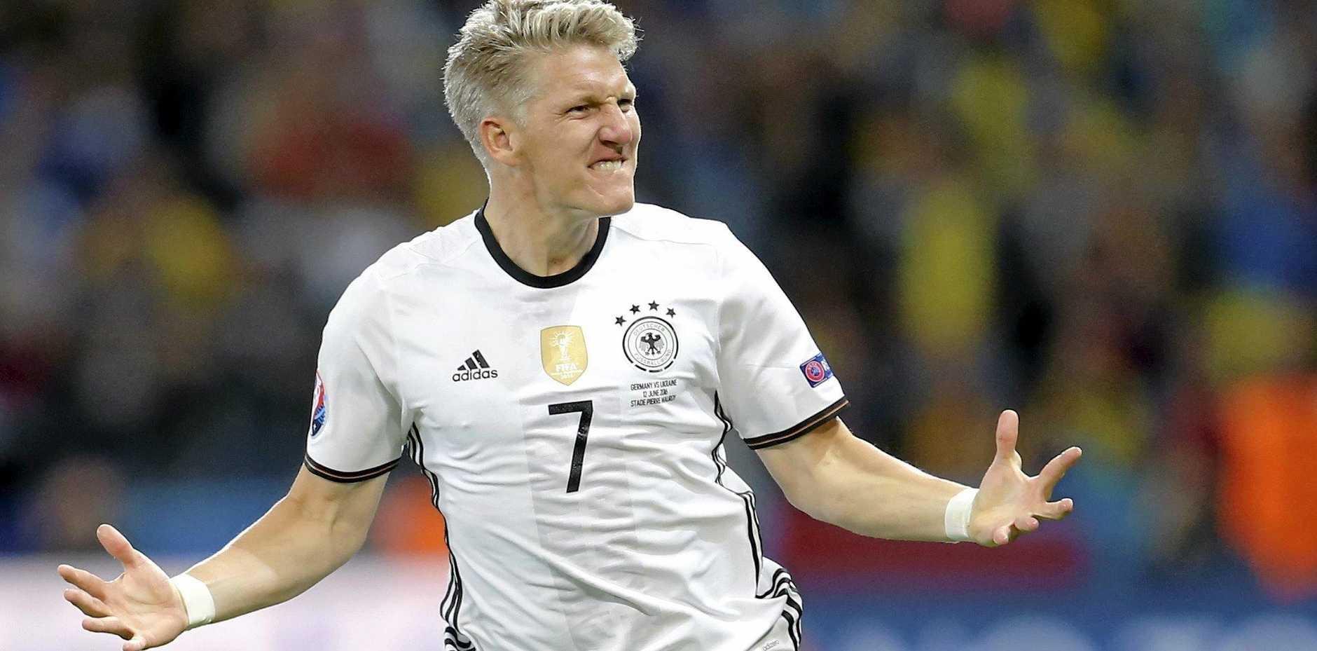 Germany's Bastian Schweinsteiger celebrates after scoring his side's second goal.