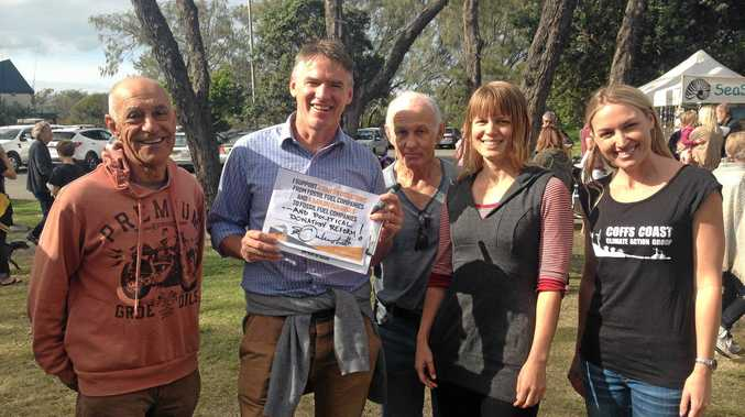 CLIMATE ACTION: Independent candidate Rob Oakeshott with Sarah Wood and other members of the climate action group at the Harbourside markets on Sunday.