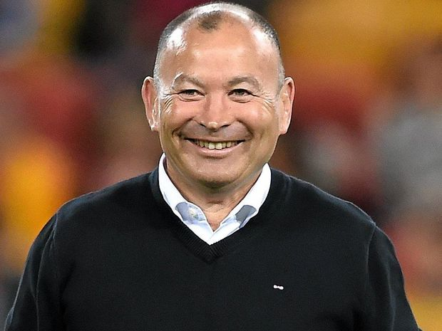 NOT HAPPY: England coach Eddie Jones smiles prior to kick off in the first Test between the Wallabies and England at Suncorp Stadium.